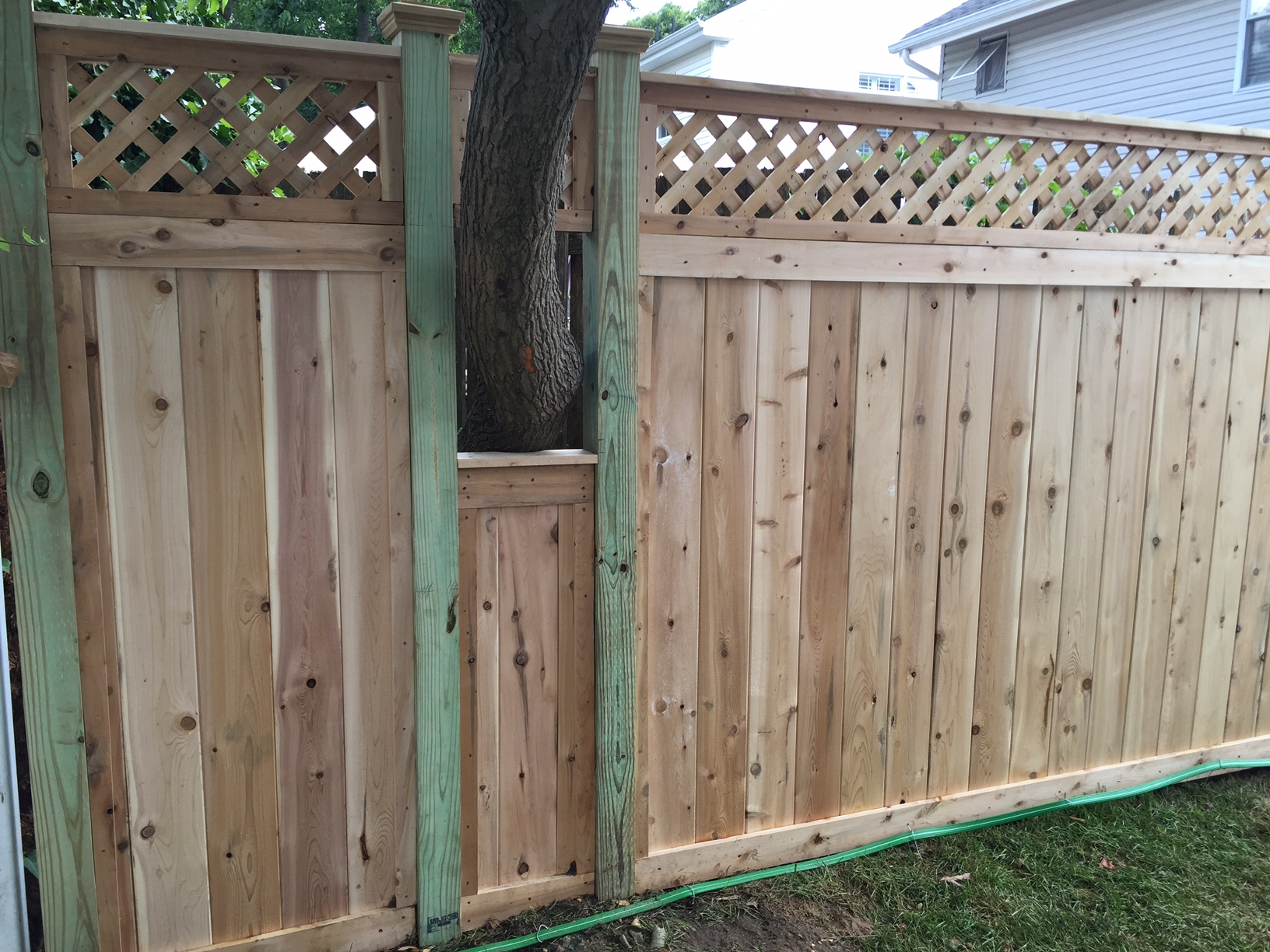 Wood fencing add a link fence company nj fence contractor cedar lattice top fence around a tree baanklon Gallery