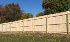 Spruce stockade fence on pressure treated posts