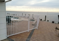 White Aluminum Fence on Pavers with Flanges