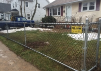 Black Chain Link Fence with Bottom Rail