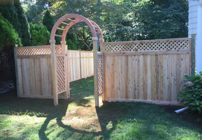 Arbor With Lattice Top Tongue and Groove Fence