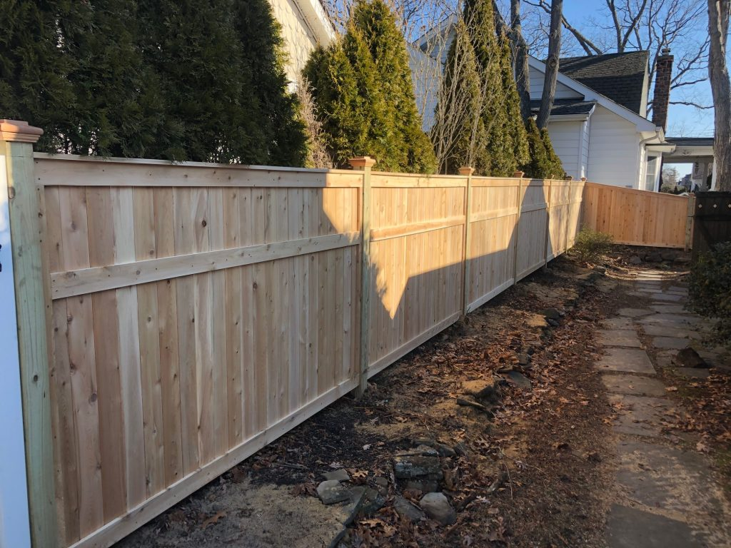 Stylish cedar tongue and groove fence for a Spring Lake, New Jersey summer house
