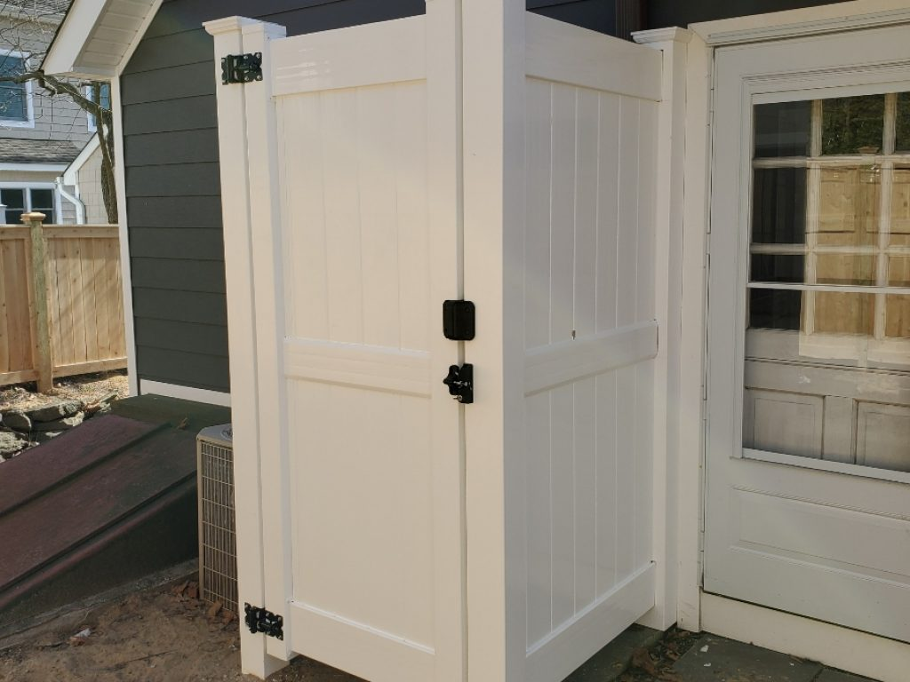 Easy, breezy white PVC shower enclosure for a beach house